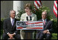 Mrs. Laura Bush is joined by U.S. Secretary of the Interior Dirk Kempthrone, left, and Jon Nau III, chairman of the Advisory Council on Historic Preservation, as she addreses guests in the White House Rose Garden, Wednesday, May 9, 2007, during the Preserve America President Awards ceremony. White House photo by Joyce Boghosian