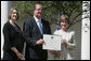 Mrs. Laura Bush poses with Mayor Wayne McCullen of Natchitoches, La., center, and Nancy Morgan, Cane River National Hertiage Area commission executive director, as she presents them with a 2007 Preserve America Presidential Award in the Rose Garden at the White House Wednesday, May 9, 2007, honored for their implementation of a comprehensive hertiage tourism plan for their region. White House photo by Joyce Boghosian