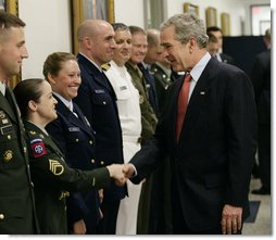 President George W. Bush greets military personnel on his visit to the Pentagon Thursday, May 10, 2007 in Arlington, Va., for a meeting with U.S. Defense Secretary Robert Gates and members of the Joint Chiefs of Staff.  White House photo by Eric Draper