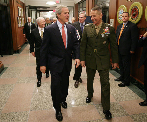 President George W. Bush is welcomed to the Pentagon by Joint Chiefs Chairman Gen. Peter Pace Thursday, May 10, 2007 in Arlington, Va., where President Bush met with U.S. Defense Secretary Robert Gates and members of the Joint Chiefs of Staff. White House photo by Eric Draper