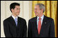 President George W. Bush welcomes Jonathan Wu of Fremont, Calif., to the stage in the East Room of the White House, where he received the President's Volunteer Service Award Thursday, May 10, 2007, in celebration of Asian Pacific American Heritage Month. White House photo by Eric Draper