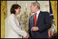 President George W. Bush congratulates military spouse Shannon Maxwell of Jacksonville, N.C., as Maxwell is presented with the President's Volunteer Service Award Friday, May 11, 2007, in the East Room of the White House during a celebration of Military Spouse Day. White House photo by Eric Draper