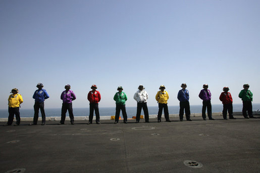 Crew members of the USS John C. Stennis stand on the deck, Friday, May 11, 2007 during Vice President Dick Cheney's arrival to the aircraft carrier. White House photo by David Bohrer