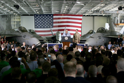 "Vice President Dick Cheney addresses U.S. troops during a rally, Friday, May 11, 2007, aboard the aircraft carrier USS John C. Stennis in the Persian Gulf. ""I've been around for a while -- so long, in fact, that I even knew Senator John Stennis personally,"" said the Vice President, adding, ""but I've never been more proud of the United States military than I am today. It's an incredibly challenging time for the country, and there's serious work being done on many fronts. You're doing all that we ask of you, and you're doing it with skill and with honor."" White House photo by David Bohrer"