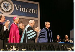 President George W. Bush is applauded by Saint Vincent College President Jim Towey, center, and Washington Archbishop Donald Wuerl as he is introduced on stage Friday, May 11, 2007, prior to delivering the commencement address at Saint Vincent College in Latrobe, Pa. White House photo by Joyce N. Boghosian
