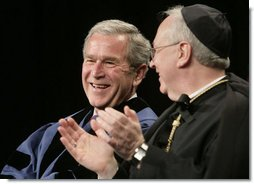 President George W. Bush, sitting with Saint Vincent College Archabbot and Chancellor Rev. Douglas Nowicki, is applauded prior to being introduced Friday, May 11, 2007, to deliver the commencement address to graduates at Saint Vincent College in Latrobe, Pa. White House photo by Joyce N. Boghosian