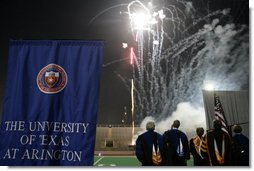 "Mrs. Bush, joined by, from left, Dan Formanowicz, Chairman of the Faculty Senate, James Spaniolo, President, UT at Arlington, Robert Estrada, Member, UT System Board of Regents, Dana Dunn, University Provost and Vice President for Academic Affairs, watch fireworks at the conclusion of the 2007 Graduation Celebration event at The University of Texas at Arlington on Friday, May 11, 2007, in Arlington, Texas. During remarks that Mrs. Bush delivered, she said, "" Class of 2007, keep this commitment to others now that you've graduated. There are so many people who need your help. Continue your tradition of service to our nation."" White House photo by Shealah Craighead"