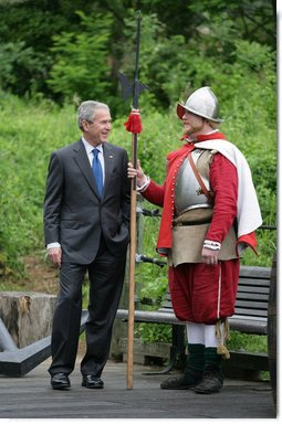 President George W. Bush stands with an actor in period garb Sunday during a tour of the Jamestown Settlement, in Jamestown, Va. The President and Mrs. Bush joined the celebration honoring the 400th anniversary of the settlement, receiving lessons in sail making and visiting the archaeological dig. White House photo by Eric Draper