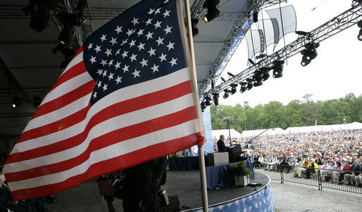 "President George W. Bush speaks Sunday, May 13, 2007, at Anniversary Park in Williamsburg, Va., where he and Mrs. Laura Bush joined in the 400th anniversary celebration of the Jamestown Settlement. ""The story of Jamestown will always have a special place in American history.It's a story of hardship overcome by resolve,"" said the President. ""It's a story of the Tidewater settlement that laid the foundation of our great democracy."" White House photo by Eric Draper"