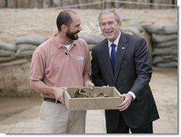 "President George W. Bush shares a moment with Michael Lavin, senior conservator at the historic Jamestowne site Sunday, May 13, 2007, during a visit by the President and Mrs. Laura Bush in celebration of the settlement's 400th anniversary. The President urged all to come and see ""the fantastic history that's on display."" He added, ""I think you'll be amazed at how our country got started.""  White House photo by Shealah Craighead"
