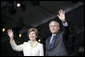 "President George W. Bush and Mrs. Laura Bush wave Sunday, May 13, 2007, as they arrive at Anniversary Park in Williamsburg, Va., where the President delivered a speech in celebration of the 400th anniversary of the Jamestown Settlement. ""Today we have no closer ally than the nation we once fought for our independence,"" said the President. ""Britain and American are united by our democratic heritage, and by the history that began at this settlement 400 years ago."" White House photo by Shealah Craighead"