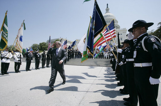 President George W. Bush salutes the color guard as he arrives at the annual Peace Officers' Memorial Service outside the U.S. Capitol Tuesday, May 15, 2007, paying tribute to law enforcement officers who were killed in the line of duty during the previous year and their families. White House photo by Joyce Boghosian