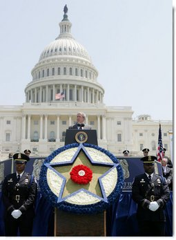 President George W. Bush addresses his remarks at the annual Peace Officers' Memorial Service outside the U.S. Capitol Tuesday, May 15, 2007, paying tribute to law enforcement officers who were killed in the line of duty during the previous year and their families. White House photo by Joyce Boghosian