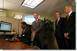 President George W. Bush is joined by Secretary Michael Chertoff, right, of the Department of Homeland Security, and Secretary Carlos Gutierrez of the Department of Commerce, as they look on during a demonstration Wednesday, May 16, 2007, of the Basic Pilot/Employment Eligibility Verification System, a voluntary program managed by U.S. Citizenship and Immigration Services that allows employers to electronically verify the eligibility of newly hired employees. The demonstration, led by Glenda Wooten-Ingram, Director of Human Resources, was held at the Embassy Suites Washington, D.C.-Convention Center, and was followed by a roundtable discussion of the program. White House photo by Joyce Boghosian