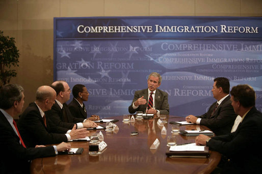 President George W. Bush participates in a roundtable discussion on comprehensive immigration reform and employment eligibility verification Wednesday, May 16, 2007, at the Embassy Suites Washington, D.C.-Convention Center. White House photo by Joyce Boghosian