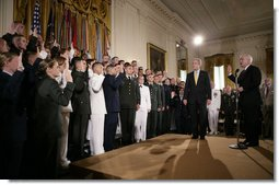 President George W. Bush attends a commissioning ceremony for Joint Reserve Officer Training Corps Thursday, May 17, 2007, in the East Room of the White House, as U.S. Secretary of Defense Robert Gates administers the commissioning oath to the ROTC members. White House photo by Eric Draper