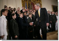 President George W. Bush congratulates newly commissioned members of the Joint Reserve Officer Training Corps Thursday, May 17, 2007, in the East Room of the White House, after U.S. Secretary of Defense Robert Gates administered the commissioning oath to the ROTC members. White House photo by Eric Draper