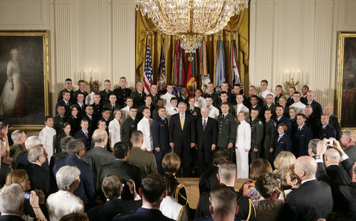 President George W. Bush and U.S. Secretary of Defense Robert Gates pose for a group photo at the commissioning ceremony for Joint Reserve Officer Training Corps Thursday, May 17, 2007, in the East Room of the White House. White House photo by Joyce Boghosian