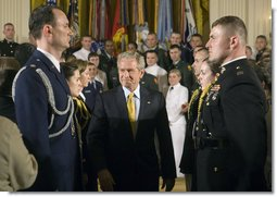 "President George W. Bush attends a commissioning ceremony for Joint Reserve Officer Training Corps Thursday, May 17, 2007, in the East Room. ""You come from different backgrounds; you represent all 50 states and the District of Columbia, as well as Guam, Puerto Rico, American Samoa and the U.S. Virgin Islands,"" said President Bush. ""And when you leave here today, you will wear on your shoulders the same powerful symbol of achievement: the gold bars of an officer of the United States Armed Forces."" White House photo by Joyce N. Boghosian"