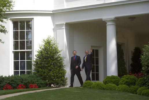 President George W. Bush and Prime Minister Tony Blair of the United Kingdom wave to the press from the Oval Office Wednesday, May 17, 2007. White House photo by Joyce Boghosian