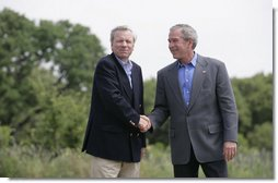 "President George W. Bush shakes hands with NATO Secretary General Jaap de Hoop Scheffer Monday, May 21, 2007, as the two wound up a visit to the Bush Ranch in Crawford, Texas. The President thanked the Secretary-General for his leadership and called him a ""strong advocate of fighting terror, spreading freedom, helping the oppressed and modernizing this important alliance."" White House photo by Shealah Craighead"