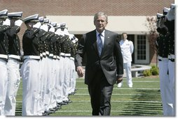 President George W. Bush is saluted by an honor cordon of U.S. Coast Guard cadets on his arrival to address the graduates Wednesday, May 23, 2007, at the U.S. Coast Guard Academy commencement in New London, Conn.  White House photo by Joyce N. Boghosian