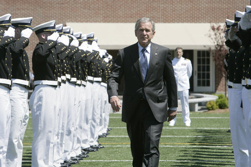 President George W. Bush is saluted by an honor cordon of U.S. Coast Guard cadets on his arrival to address the graduates Wednesday, May 23, 2007, at the U.S. Coast Guard Academy commencement in New London, Conn. White House photo by Joyce Boghosian