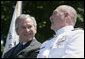 President George W. Bush talks with Admiral Thad Allen, Commandant of the U.S. Coast Guard, Wednesday, May 23, 2007, at the U.S. Coast Guard Academy commencement in New London, Conn. White House photo by Joyce Boghosian