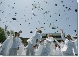 Following President George W. Bush's address to U.S. Coast Guard Academy graduates Wednesday, May 23, 2007, in New London, Conn., cadets toss their hats into the air. White House photo by Joyce N. Boghosian
