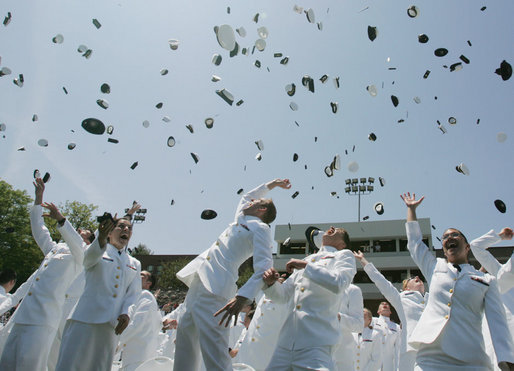 Following President George W. Bush's address to U.S. Coast Guard Academy graduates Wednesday, May 23, 2007, in New London, Conn., cadets toss their hats into the air. White House photo by Joyce Boghosian