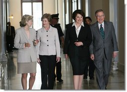 Mrs. Laura Bush is joined by U.S. Senators Kay Bailey Hutchison, R-Texas, left, Dianne Feinstein, D-Calif. and Mitch McConnell, R-Ky, right, as she arrives to attend the Senate Women's Caucus Wednesday, May 23, 2007 at the U.S. Capitol in Washington, D.C., calling for the unconditional release of Nobel laureate and Myanmar opposition leader Aung San Suu Kyi. White House photo by Shealah Craighead