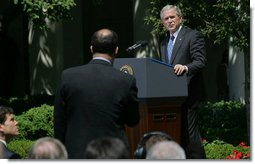 "President George W. Bush listens to a question Thursday, May 24, 2007, during a press conference in the Rose Garden. The President said, ""Today, Congress will vote on legislation that provides our troops with the funds they need. It makes clear that our Iraqi partners must demonstrate progress on security and reconciliation. As a result, we removed the arbitrary timetables for withdrawal and the restrictions on our military commanders that some in Congress have supported.""  White House photo by Chris Greenberg"