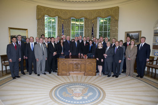 "President George W. Bush stands with the recipients of the 2006 President's ""E"" award and ""E"" Star award for export achievement, May 24, 2007, in the Oval Office. The ""E"" Award is presented by the Department of Commerce to persons and organizations engaged in the marketing of products that make significant contributions to the expansion of the export trade of the United States. White House photo by Joyce Boghosian"