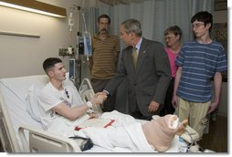 President George W. Bush shakes the hand of Cpl. Ryan T. Dion of Manchester, Conn., after awarding him a Purple Heart Thursday, May 25, 2007, during a visit to the National Naval Medical Center in Bethesda, Md., where the Marine is recovering from wounds received in Operation Iraqi Freedom. With them are Cpl. Dion's parents, Thomas and Patricia Dion, and brother, Justin. White House photo by Joyce Boghosian