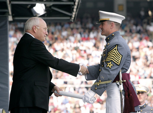 Vice President Dick Cheney presents a diploma to a U.S. Military Academy graduate during commencement ceremonies at Michie Stadium Saturday, May 26, 2007, in West Point, N.Y. White House photo by David Bohrer