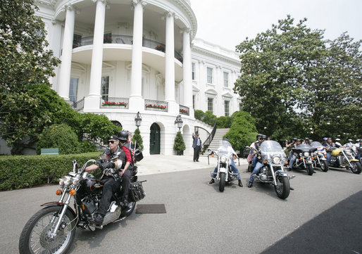 President George W. Bush bids farewell to members of the Rolling Thunder motorcycle organization, as they drive away from the South Portico of the White House following their visit Sunday, May 27, 2007. Rolling Thunder, founded by a group of Vietnam veterans in 1987, marks its 20th year of supporting U.S. troops overseas, at home and missing in action. White House photo by Joyce Boghosian