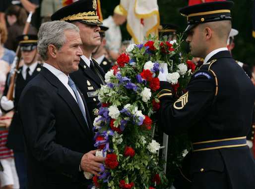 President George W. Bush is joined by Major General Guy Swan III, left, commander of the Military District of Washington, during the Memorial Day commemoration wreath laying ceremony at the Tomb of the Unknowns Monday, May 28, 2007, at Arlington National Cemetery in Arlington, VA. White House photo by Chris Greenberg