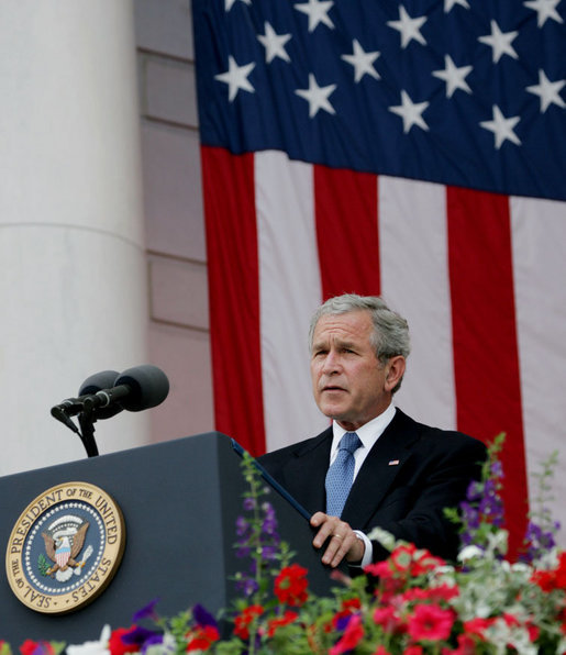 "President George W. Bush addresses his remarks at the Memorial Day commemoration ceremony Monday, May 28, 2007, at Arlington National Cemetery in Arlington, Va. Addressing the gathered audience President Bush said, ""The greatest memorial to our fallen troops cannot be found in the words we say or the places we gather. The more lasting tribute is all around us—a country where citizens have the right to worship as they want, to march for what they believe, and to say what they think."" White House photo by Chris Greenberg"