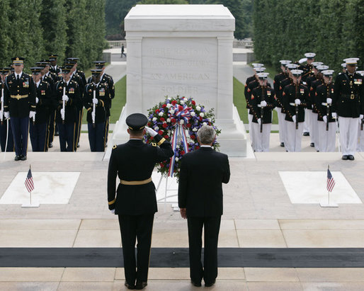 President George W. Bush is joined by Major General Guy Swan III, left, commander of the Military District of Washington, during the Memorial Day commemoration wreath laying ceremony at the Tomb of the Unknowns Monday, May 28, 2007, at Arlington National Cemetery in Arlington, VA. White House photo by Shealah Craighead