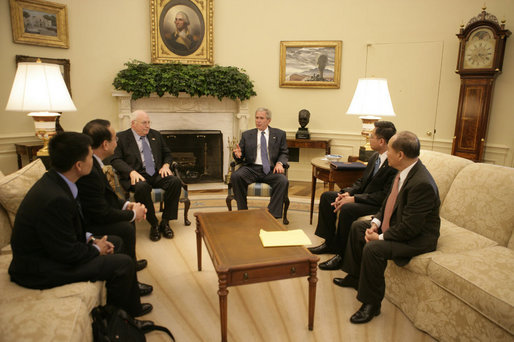 President George W. Bush meets with Vietnamese democracy and human rights activists Tuesday, May 29, 2007, in the Oval Office of the White House. White House photo by Joyce Boghosian