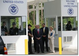 President George W. Bush listens as Ed Cassidy, Assistant Director of U.S. Customs and Border Protection, explains the procedures at a simulated border crossing during in a tour Tuesday, May 29, 2007, of the Federal Law Enforcement Training Center in Glynco, Ga. The President spent the day in Georgia where he was briefed on wildfires and also delivered remarks on comprehensive immigration reform.  White House photo by Eric Draper