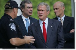 President George W. Bush listens to Ed Cassidy, Assistant Director of U.S. Customs and Border Protection, during a tour Tuesday, May 29, 2007, of the Federal Law Enforcement Training Center in Glynco, Ga. Joining the President are Secretary Michael Chertoff of the Department of Homeland Security, and Secretary Carlos Gutierrez of the Department of Commerce.  White House photo by Chris Greenberg