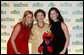 Mrs. Laura Bush is joined by her daughters Jenna Bush, left, and Barbara Bush, as they pose for a photo with Sesame Street character Elmo Wednesday evening, May 30, 2007, at the Sesame Workshop Fifth Annual Benefit Dinner in New York, where Mrs. Bush was honored for her commitment to literacy and education. White House photo by Shealah Craighead