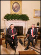 President George W. Bush listens as President Jalal Talabani of Iraq addresses members of the media in the Oval Office Thursday, May 31, 2007. White House photo by Eric Draper