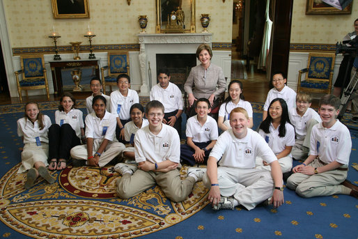 Mrs. Laura Bush meets with the 15 Scripps National Spelling Bee Championship finalists during an ABC television taping at the White House Thursday, May 31, 2007, to be aired on ABC during the final round Thursday evening. From left to right are Tia Natasha-Elizabeth Thomas of Coarsegold, Calif.; Isabel A. Jacobson of Madison, Wis.; Joseph Henares of Avon, Conn.; Cody Wang of Alberta, Canada; Nithya P. Vijayakumar of Canton, Mich.; Kavya Shivashankar of Olathe, Kansas; Prateek Kohli of Westbury, N.Y.; Jonathan Horton, front-left center, of Gilbert, Ariz.; Evan M. O'Dorney, center, of Danville, Calif.; Connor W. Spencer, front-right center,of Platte City, Mo.; Amy Chyao, back-row next to Mrs. Bush, of Richardson, Texas; Claire Zhang of Jupiter, Fla.; Anqi Dong, upper-right, of Saskatoon, Saskatchewan, Canada; Nate Gartke , center far-right, of Spruce Grove, Alberta, Canada; and Matthew Evans, far-right, of Albuquerque, N.Mex. White House photo by Shealah Craighead