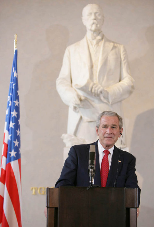 President George W. Bush listens to a reporter's question at a joint news conference Tuesday, June 5, 2007, where he was joined by Czech President Vaclav Klaus and Czech Prime Minister Mirek Topolanek, at Prague Castle in the Czech Republic. White House photo by Chris Greenberg