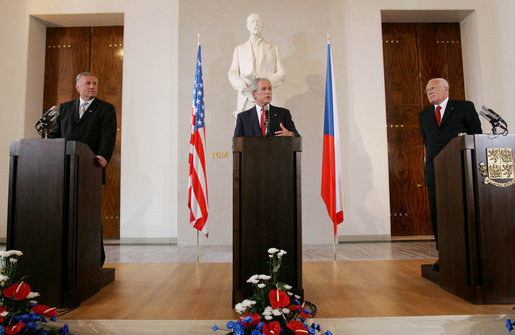 President George W. Bush addresses a joint news conference Tuesday, June 5, 2007, joined by Czech President Vaclav Klaus, right, and Czech Prime Minister Mirek Topolanek, left, at Prague Castle in the Czech Republic. White House photo by Chris Greenberg