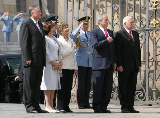 President George W. Bush and Mrs. Laura Bush listen to the U.S. National Anthem on their arrival to Prague Castle in the Czech Republic Tuesday, June 5, 2007, welcomed by Czech President Vaclav Klaus, right; his wife, Livia Klausova and Czech Prime Minister Mirek Topolanek, left. White House photo by Chris Greenberg