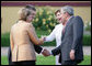 President George W. Bush and Mrs. Laura Bush are greeted by Germany's Chancellor Angela Merkel and her husband, Dr. Joachim Sauer, upon their arrival Wednesday, June 6, 2007, at Hohen Luckow Estate in Hohen Luckow, Germany, for the dinner with G8 leaders and spouses. White House photo by Eric Draper