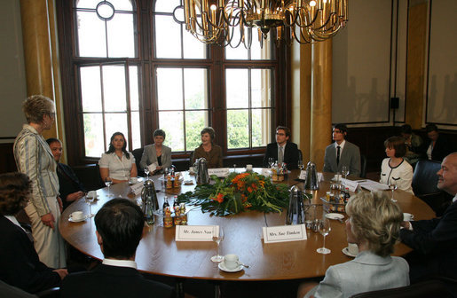 Mrs. Laura Bush listens to Sylvia Bretschneider, President of the State Parliament, during a roundtable discussion Wednesday, June 6, 2007, with Fulbright Scholars at the Schwerin Castle in Schwerin, Germany. Established in 1946, more than 279,000 scholars have participated in the program worldwide. White House photo by Shealah Craighead